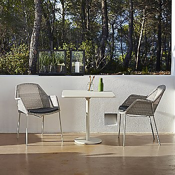 Breeze Outdoor Stackable Armchair Cushion / in use