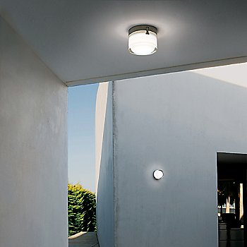 In use as a ceiling light and wall sconce outdoors, illuminated